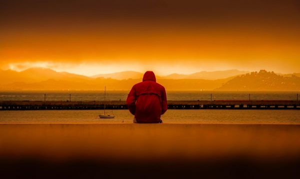 hypnosis depression guy in front of sea