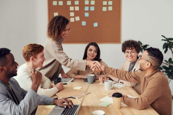 woman shaking hands at presentation