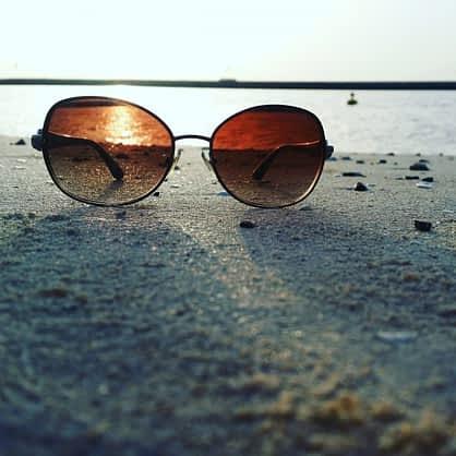 glasses focused on sunset