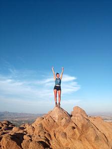 sportswoman on top of a mountain